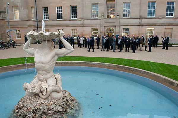 The fountain outside the Oxford University faculty of Philosophy building, with students in the background.