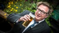 Philosophers arms podcast portrait of presenter Matthew Sweet drinking a pint